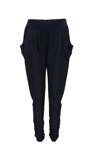 """These navy peg trousers are really lovely. The wool mix gives it a comfortable autumn/winter feel and I just love the ruching and the cut, it makes me feel so stylish. I don't normally wear peg trousers, I tend to live in jeans and jeggings, but these sit really nicely on me so make a good change and I feel confident when I wear them."" - S, Garratt"